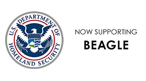 "U.S. Department of Homeland Security Seal - A graphically styled American eagle with outstretched wings, a shield on its chest, and in its claws are an olive branch with 13 leaves and 12 arrows. In the outer ring of this circular seal are the words ""U.S. DEPARTMENT OF"" in the top half and ""HOMELAND SECURITY"" in the bottom half."